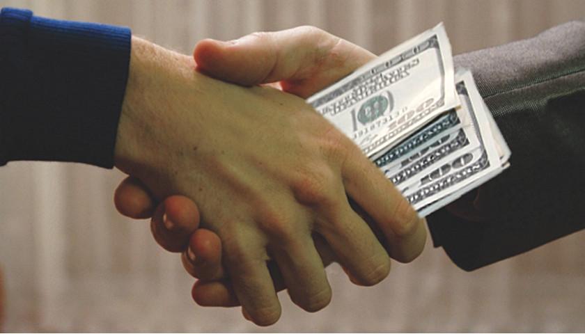 sly bribe