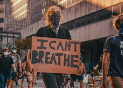 "George Floyd protest in Minneapolis with ""I can't breathe"" cardboard sign"