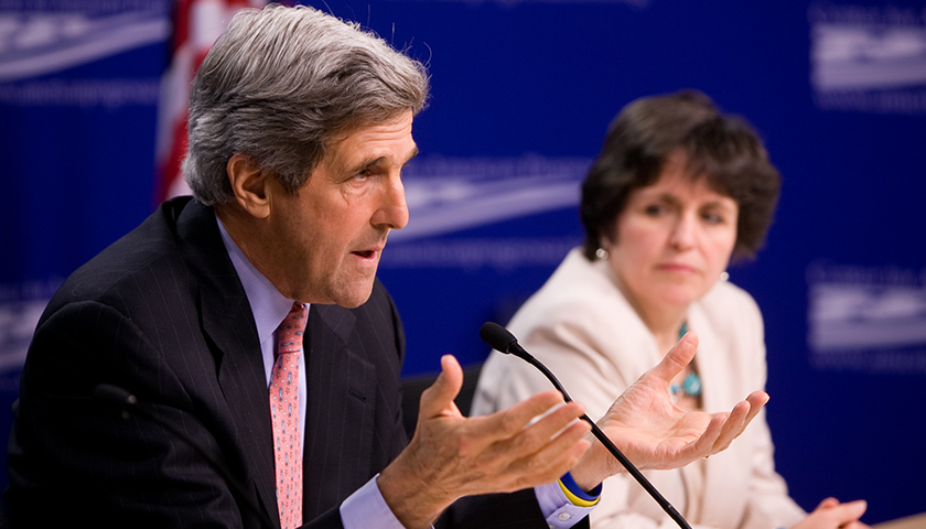 John Kerry with Sarah Rosen Wartell in background