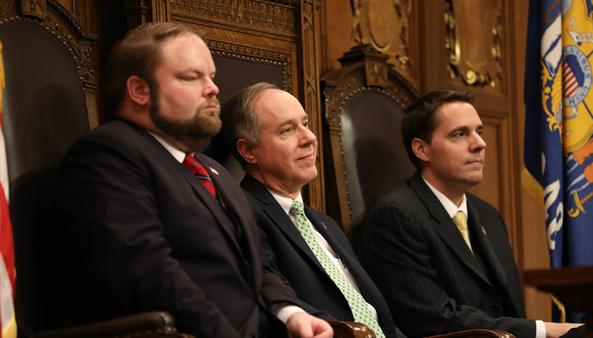 Governor Tony Evers gives his first State of the State address in Madison, Wisconsin, at the State Capitol building on Jan. 22, 2019. He addressed a joint meeting of the Assembly and the Senate. Seen here, from left, are Speaker Pro Tempore Rep. Tyler August, R-Lake Geneva, Assembly Speaker Robin Vos, R-Rochester and President of the Senate Roger Roth, R-Appleton.