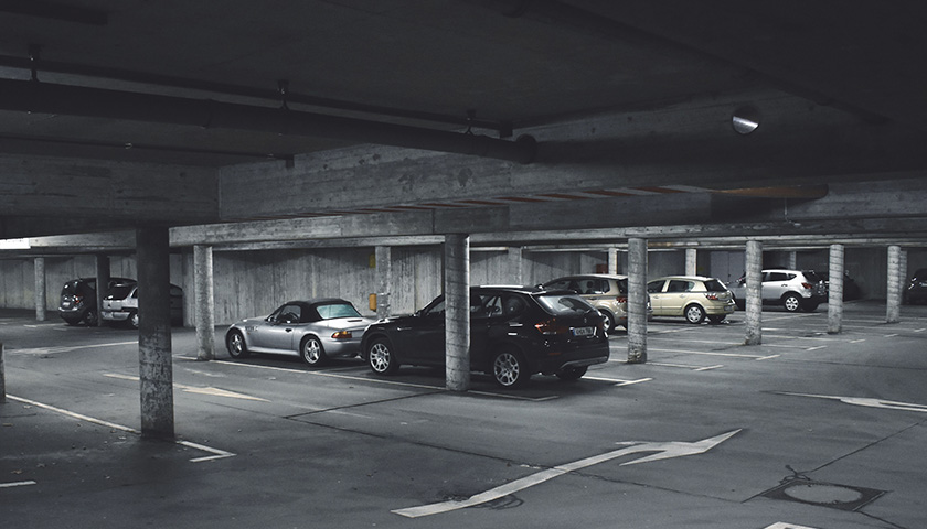 Cars in a parking garage at night