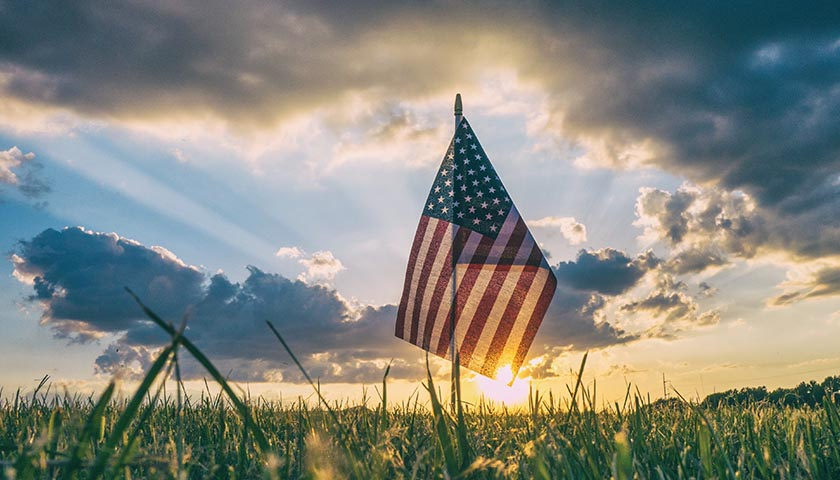 American flag in the grass