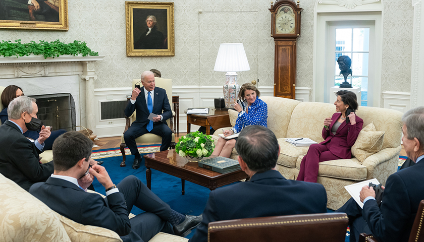 Joe Biden and his administration sitting in the Oval Office at the White House
