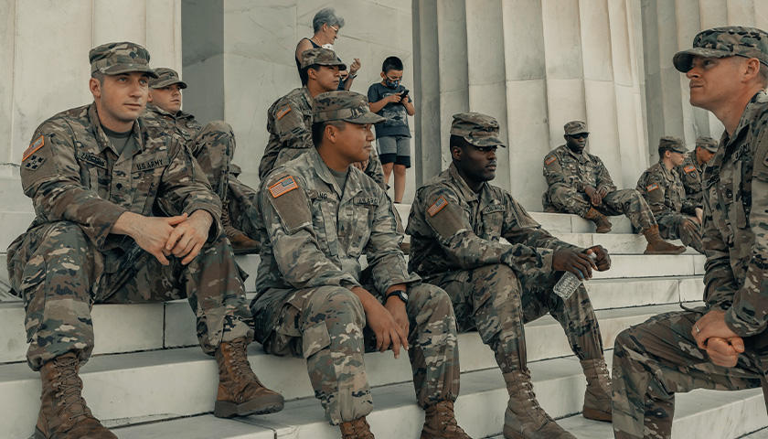 Military men in uniform, on the steps of the National Mall in Washington D.C.
