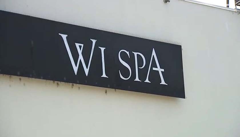 Close up of Wi Spa sign on building