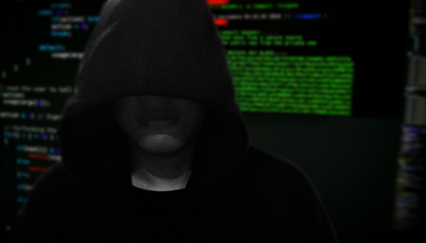 silhouette of person with hoodie on