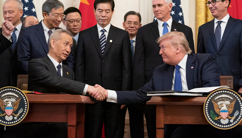 President Donald J. Trump, joined by Chinese Vice Premier Liu He, sign the U.S. China Phase One Trade Agreement Wednesday, Jan. 15, 2020, in the East Room of the White House. (Official White House Photo by Shealah Craighead)